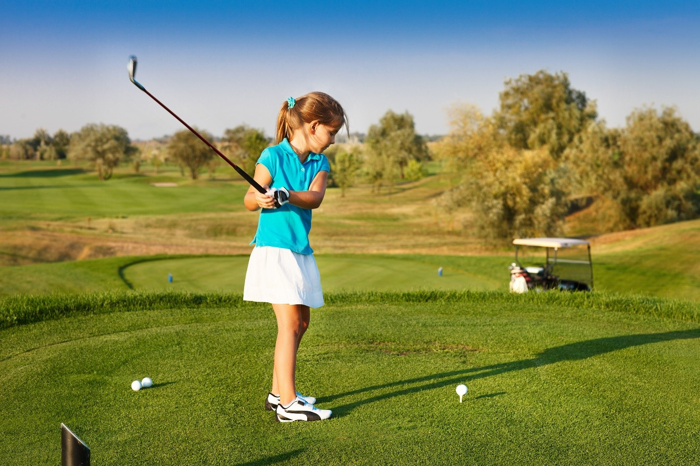 girl junior golfer practicing