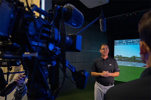A spokeperson from Foresight Sports talking to the camera at the 2020 PGA Merchandise Show in Orlanda, Florida.