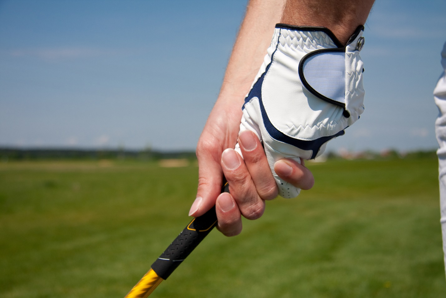 The interlocking grip in golf.