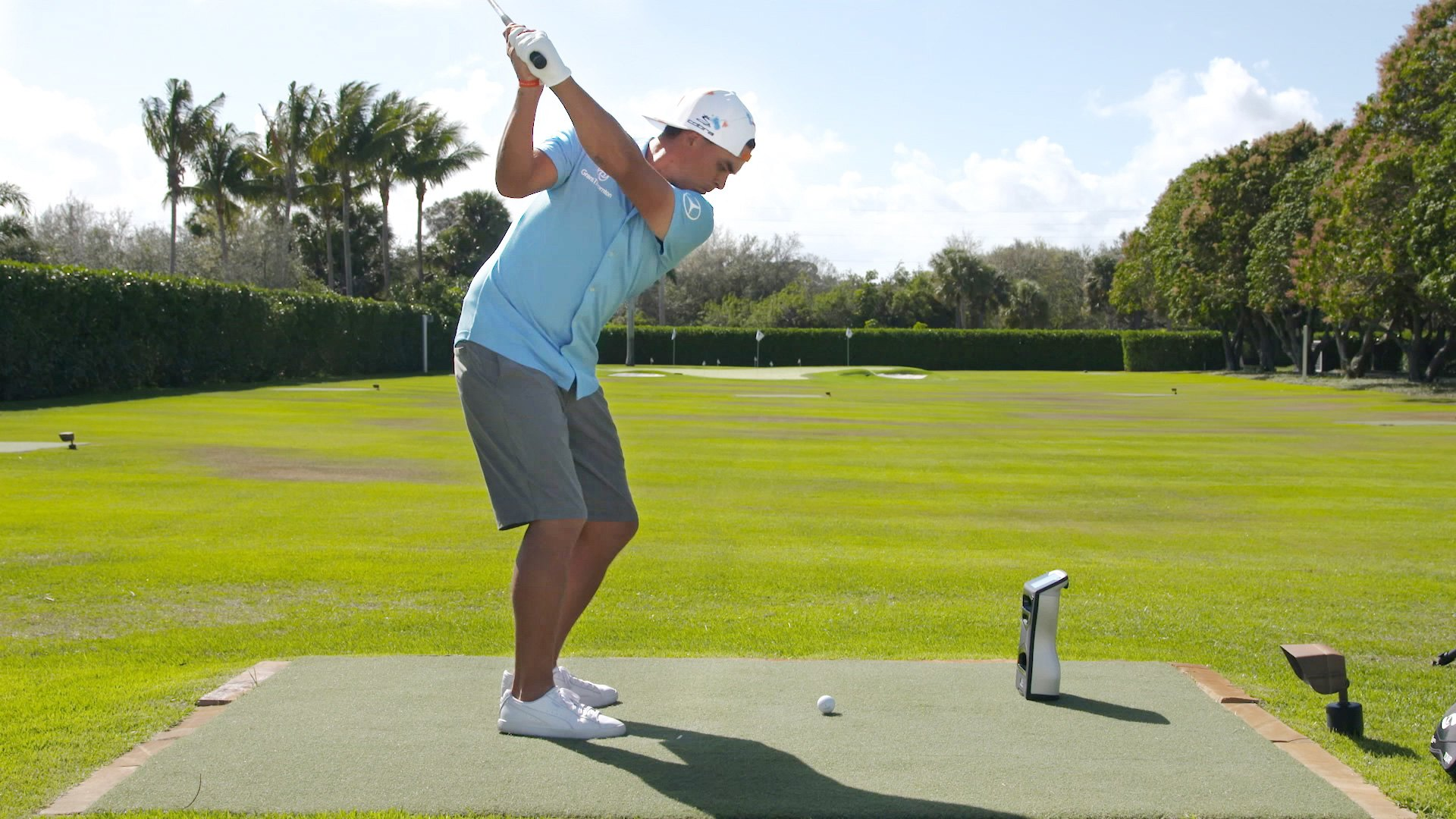 Rickie Fowler practicing at home with a GCQuad launch monitor.