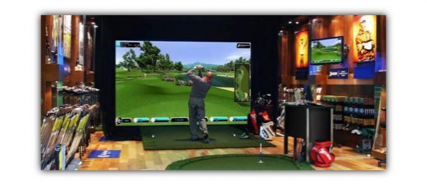 A customer testing a golf launch monitor in store.