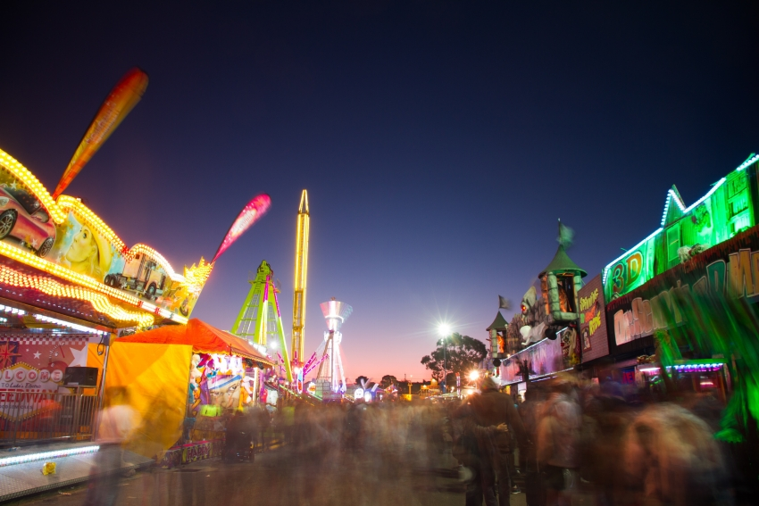 games at a county fair at night
