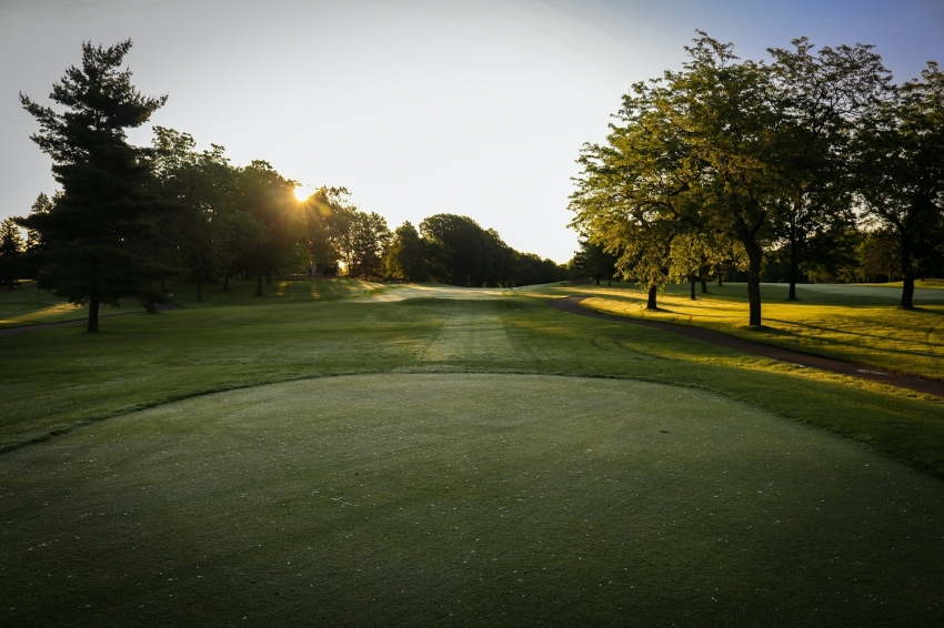 The greens and the fairway of the golf course in the morning