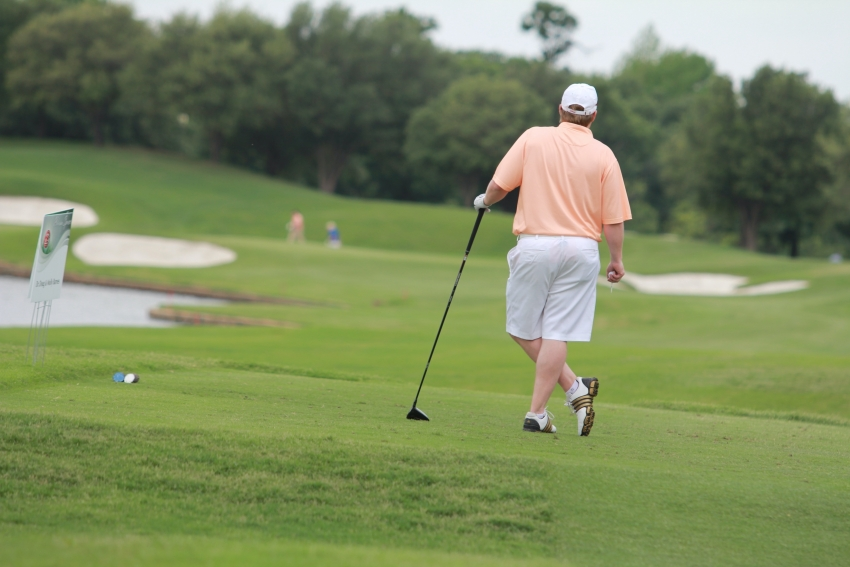 A golfer playing on a course.