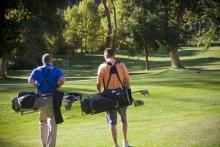Golfers walking on fairway