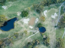 Sand bunkers surrounding hole